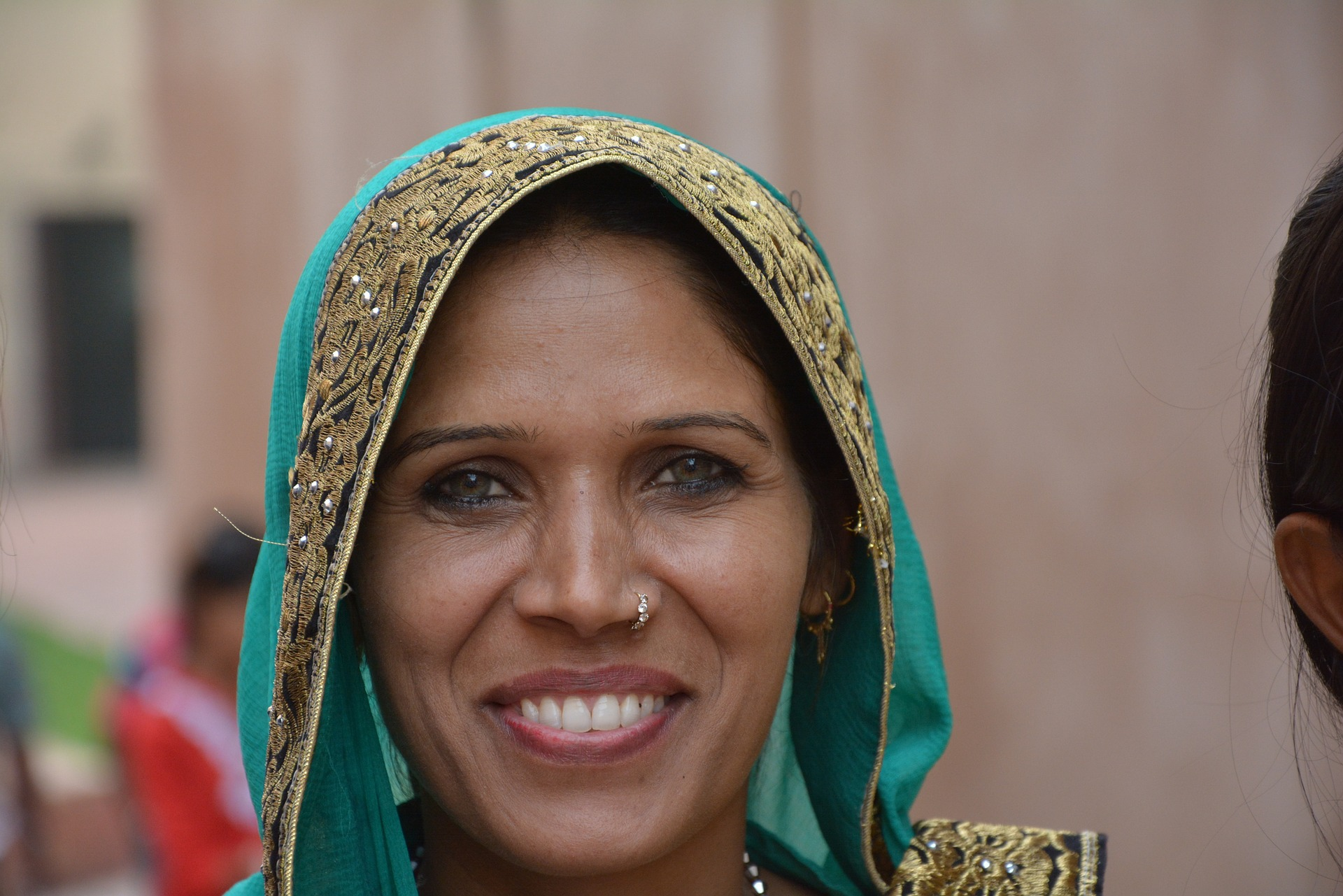 South Asian woman smiling in sari