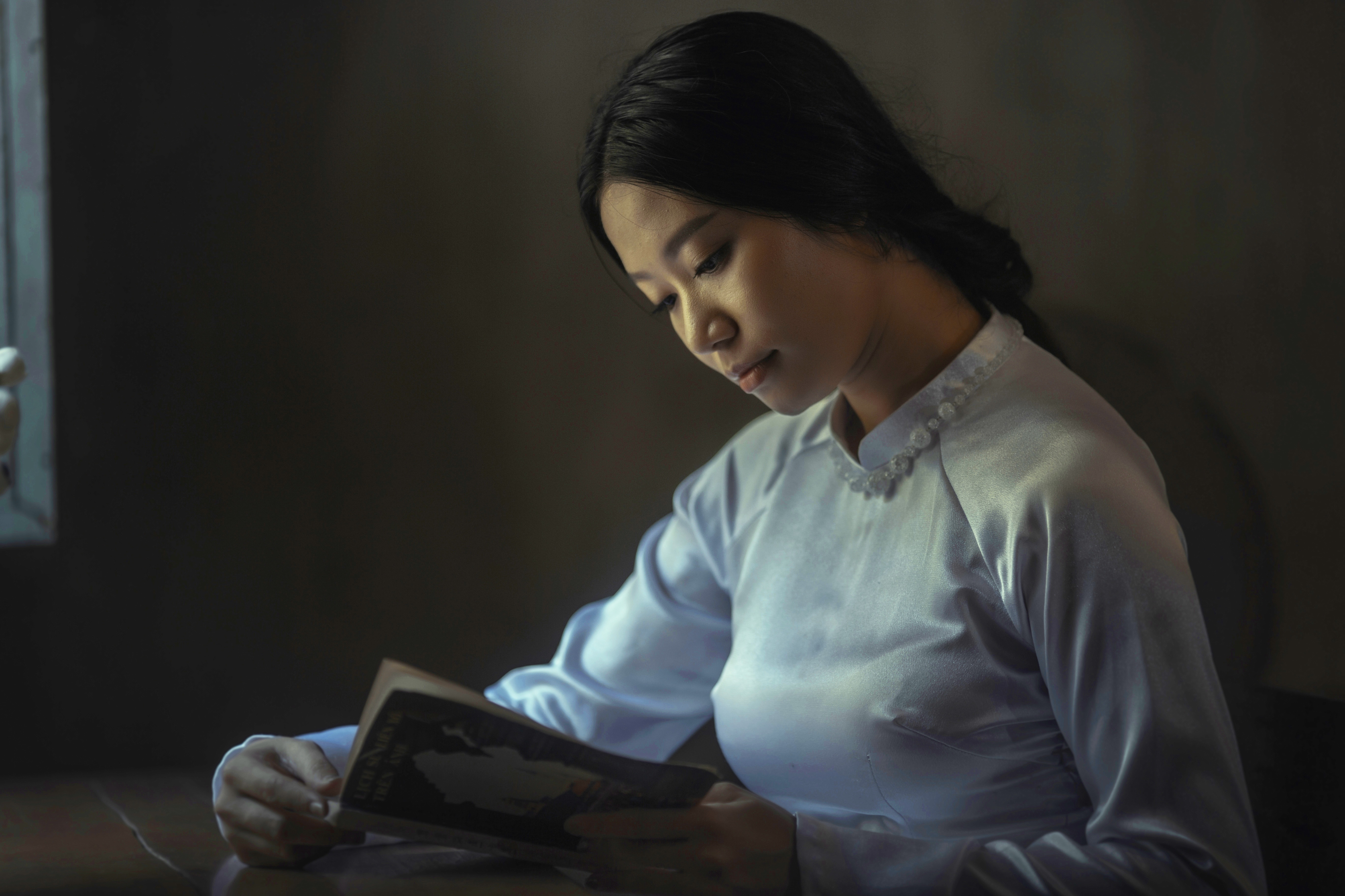 Asian woman reading