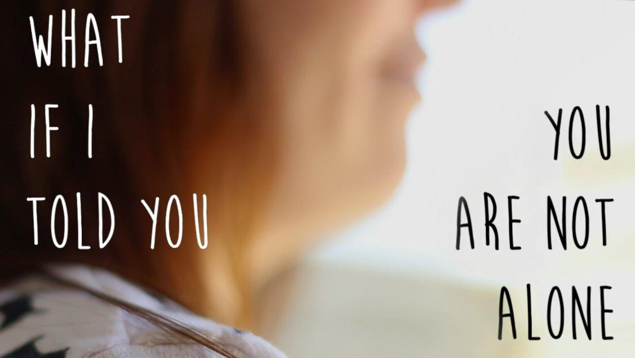 "Photo of Woman in side view, with words ""What if I told you, you are not alone?"""