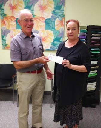 Executive Director Lynda Kosowan receiving a donor cheque.