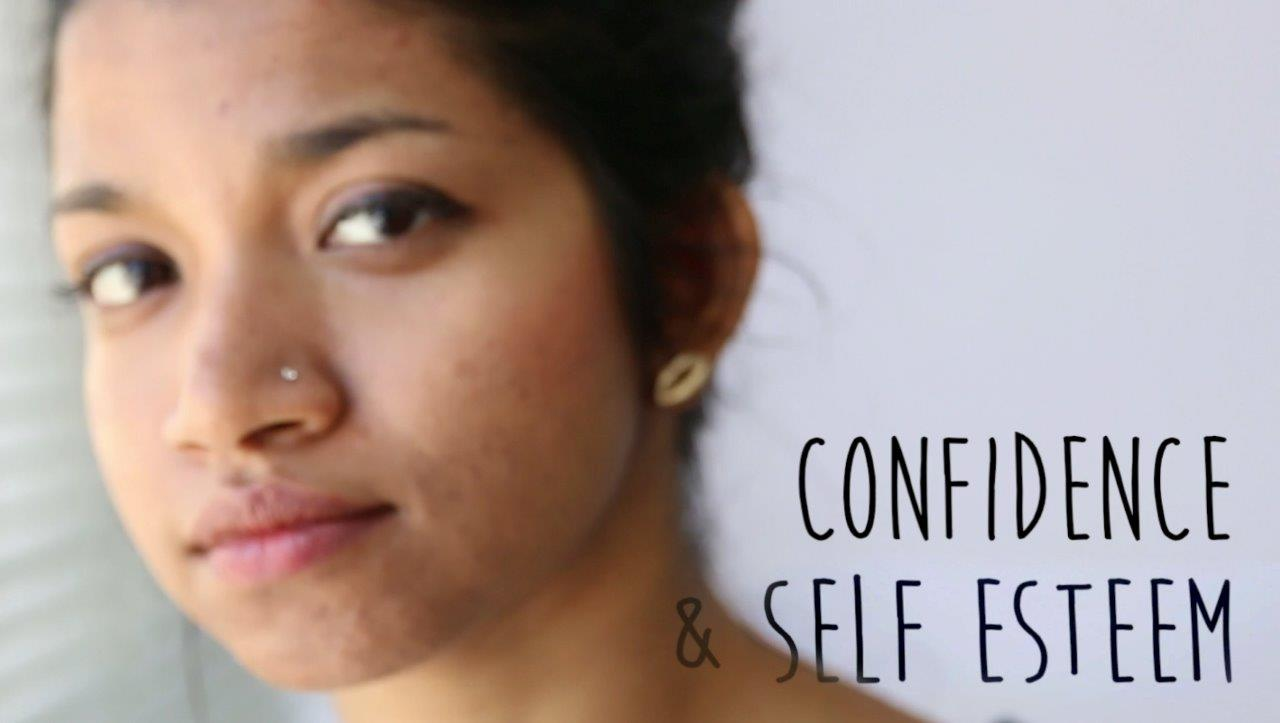 """Young brown woman with words """"Confidence and self esteem"""""""