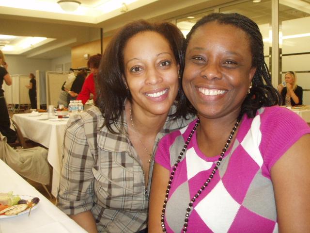 Two black women enjoying an SWC event
