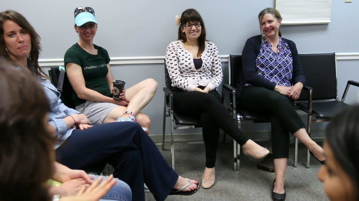 Diverse women in a circle at a workshop